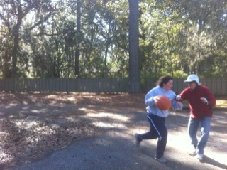 Cami and Papa playing basketball